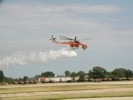 Erickson Aircrane water bomber droping water.