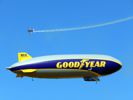Goodyear airship and airplane.